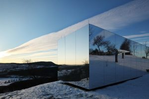 Mirrored Modular Housing Creates Casa Invisible in Austria