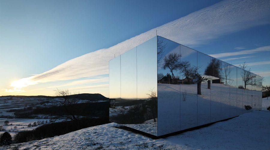 Mirrored Modular Housing Creates Casa Invisible in Austria